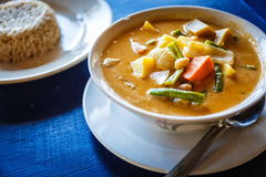 Thai tasty soup. Thai soup and rice on table in restaurant in Thailand royalty free stock image