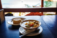 Thai tasty soup. Thai soup and rice on table in restaurant in Thailand royalty free stock images