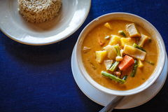 Thai tasty soup. Thai soup and rice on table in restaurant in Thailand royalty free stock photography