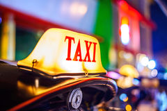Thai Taxi (Tuk Tuk) sign with defocused lights blur , Chiang Mai Stock Photography