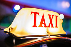 Thai Taxi (Tuk Tuk) sign with defocused lights blur , Chiang Mai Royalty Free Stock Images