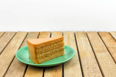 Thai tea cake. On wood table Royalty Free Stock Images