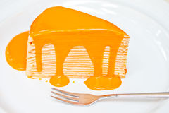 Thai tea crepe cake with fork Royalty Free Stock Photos