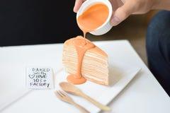 Thai Tea Crepe Cake. Pouring with the Thai Tea sweet cream Stock Photography