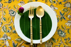 Thai tea and dessert cafe Place setting. Spoon and fork with flower decoration stock image