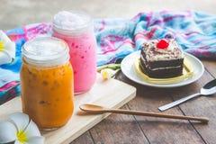 Thai tea milkshake and pink milkshake beverage and cake chocolat Stock Image