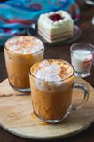 Thai tea milkshank sweet drink on the glass for refreshment Royalty Free Stock Photo