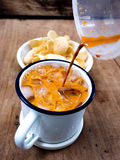 Thai tea pour in to zinc cup Stock Photography