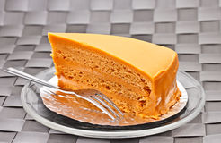 Thai tea soft layer cake on glass plate 1 Stock Photos