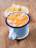Thai tea in zinc cup Royalty Free Stock Image