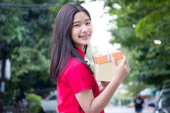 Thai teen beautiful girl in Chinese dress, happy new year and give gift, relax and smile. Royalty Free Stock Photo