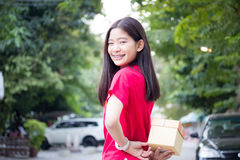 Thai teen beautiful girl in Chinese dress, happy new year and give gift, relax and smile. Stock Photo