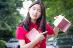 Thai teen beautiful girl in Chinese dress, happy new year and open box gift, unhappy. Royalty Free Stock Photo