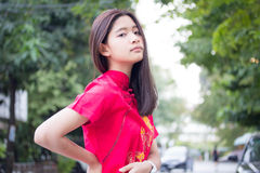 Thai teen beautiful girl in Chinese dress, relax and smile. Royalty Free Stock Photos