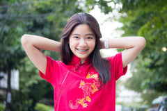 Thai teen beautiful girl in Chinese dress, relax and smile. Royalty Free Stock Image