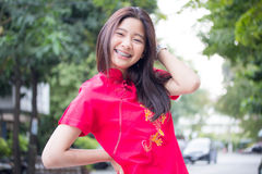 Thai teen beautiful girl in Chinese dress, relax and smile. Royalty Free Stock Images