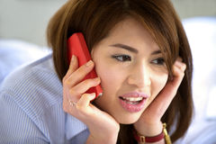 Thai teen girl smile with mobile phone Royalty Free Stock Image