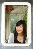 Thai teenager in train window frame Royalty Free Stock Photo