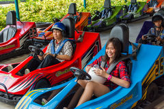 Thai teens perpare for a go-kart race Royalty Free Stock Photo