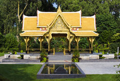 Thai Temple. With Reflection Pond and Grass royalty free stock images