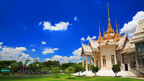 Thai temple against blue sky in Korat Stock Image
