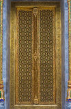Thai Temple carving door with golden decoration Stock Photo