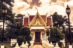 Thai temple and cloudy sky in sun shine. Thai temple and cloudy sky in sun shine Royalty Free Stock Photo