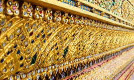 Thai Temple Decor. Ornate wall outside of a Thai temple Stock Image