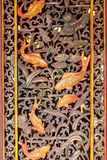 Thai temple door decoration with Golden fish Stock Photo