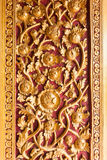 Thai temple door decoration with Golden Flower Royalty Free Stock Photography