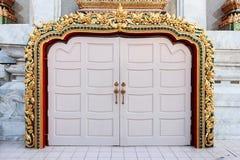 Thai temple door sculpture. Arch door of buddhism temple. Stock Images