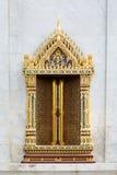 Thai temple door sculpture Royalty Free Stock Photo