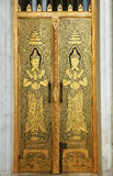 Thai temple door sculpture Royalty Free Stock Image