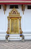 Thai temple door sculpture Royalty Free Stock Photography