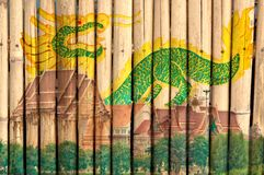 Thai Temple and Dragon Painting on Bamboo Fence Royalty Free Stock Image