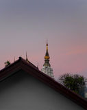 Thai temple in early morning light stock photo