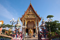 Thai temple with giant at the gate Royalty Free Stock Image