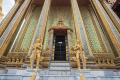 Thai temple golden gate and golden giants. Thai Architecture golden gate and giants Stock Image