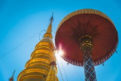 Thai temple golden pagoda in northern with blue sky Stock Photo