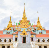 Thai temple with golden pagoda Royalty Free Stock Photos