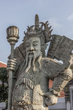 Thai temple guard_5. Stone god or demon guard of wat pho temple Royalty Free Stock Images