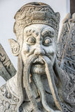 Thai temple guard_11. Stone god or demon guard of wat pho temple Stock Images