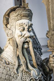Thai temple guard_10. Stone god or demon guard of wat pho temple Stock Photos