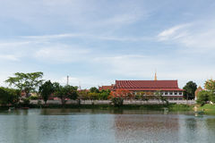 The thai temple near lake with blue sky Royalty Free Stock Image