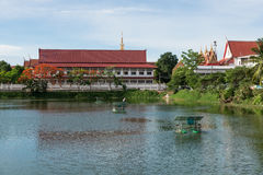 The thai temple near lake with water turbine by solar cell Stock Photos