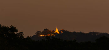 Thai temple in night illumination. Thai temple on the hill in night illumination Stock Photos