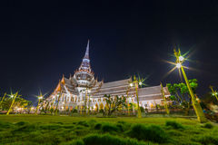 Thai temple. Night photo of Wat sothornwararam (Thai temple) during Magha Puja day, the one of important day for Buddhism religion. This place is public famous Stock Photo