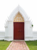 Thai temple red door and white wall Royalty Free Stock Photo
