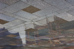 Thai temple reflection in Granite flooring. Surface Stock Photo