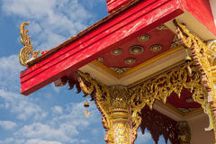 Thai temple roof with blue sky Stock Images